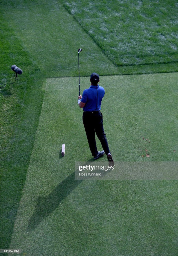 Tiger Woods o f the USA watches his tee shot on the 16th tee during the first round of the Omega Dubai Desert Classic at Emirates Golf Club on February 2, 2017 in Dubai, United Arab Emirates.