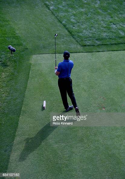 Tiger Woods o f the USA watches his tee shot on the 16th tee during the first round of the Omega Dubai Desert Classic at Emirates Golf Club on...