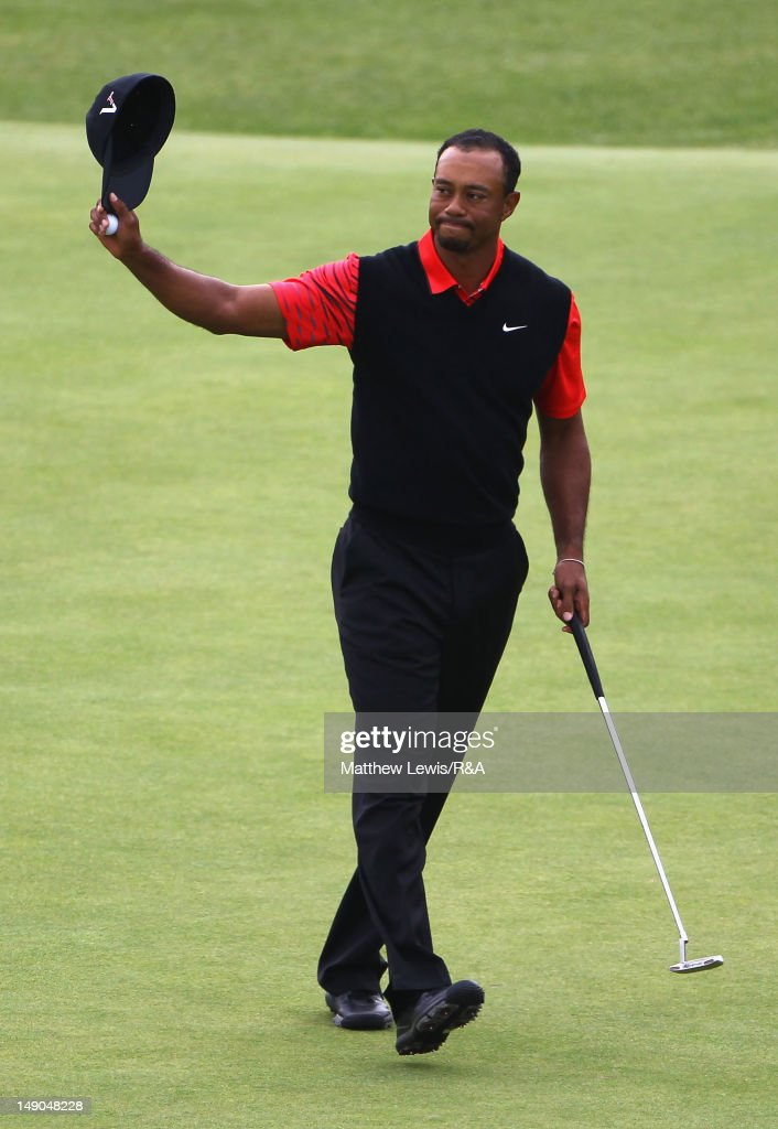 <a gi-track='captionPersonalityLinkClicked' href=/galleries/search?phrase=Tiger+Woods&family=editorial&specificpeople=157537 ng-click='$event.stopPropagation()'>Tiger Woods</a> of the United States acknowledges the crowd on the 18th green during the final round of the 141st Open Championship at Royal Lytham & St. Annes Golf Club on July 22, 2012 in Lytham St Annes, England.