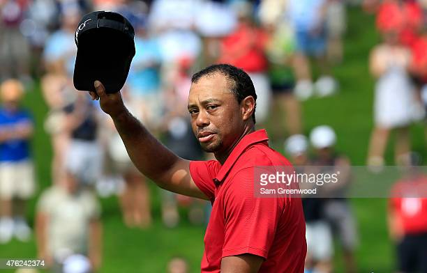 Tiger Woods of the United States acknowledges the crowd on the 18th hole during the final round of The Memorial Tournament presented by Nationwide at...