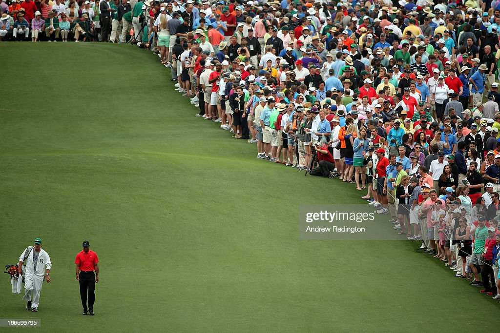 <a gi-track='captionPersonalityLinkClicked' href=/galleries/search?phrase=Tiger+Woods&family=editorial&specificpeople=157537 ng-click='$event.stopPropagation()'>Tiger Woods</a> of the United States and caddie <a gi-track='captionPersonalityLinkClicked' href=/galleries/search?phrase=Joe+LaCava&family=editorial&specificpeople=695531 ng-click='$event.stopPropagation()'>Joe LaCava</a> walk up the first fairway during the final round of the 2013 Masters Tournament at Augusta National Golf Club on April 14, 2013 in Augusta, Georgia.