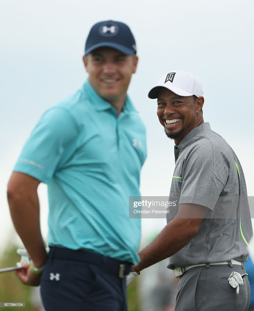 Tiger Woods (R) of the United States and Jordan Spieth (L) of the United States laugh on the practice range during round three of the Hero World Challenge at Albany, The Bahamas on December 3, 2016 in Nassau, Bahamas.