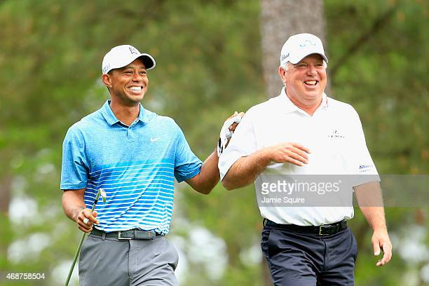 Tiger Woods of the United States and Mark O'Meara of the United States share a laugh during a practice round prior to the start of the 2015 Masters...