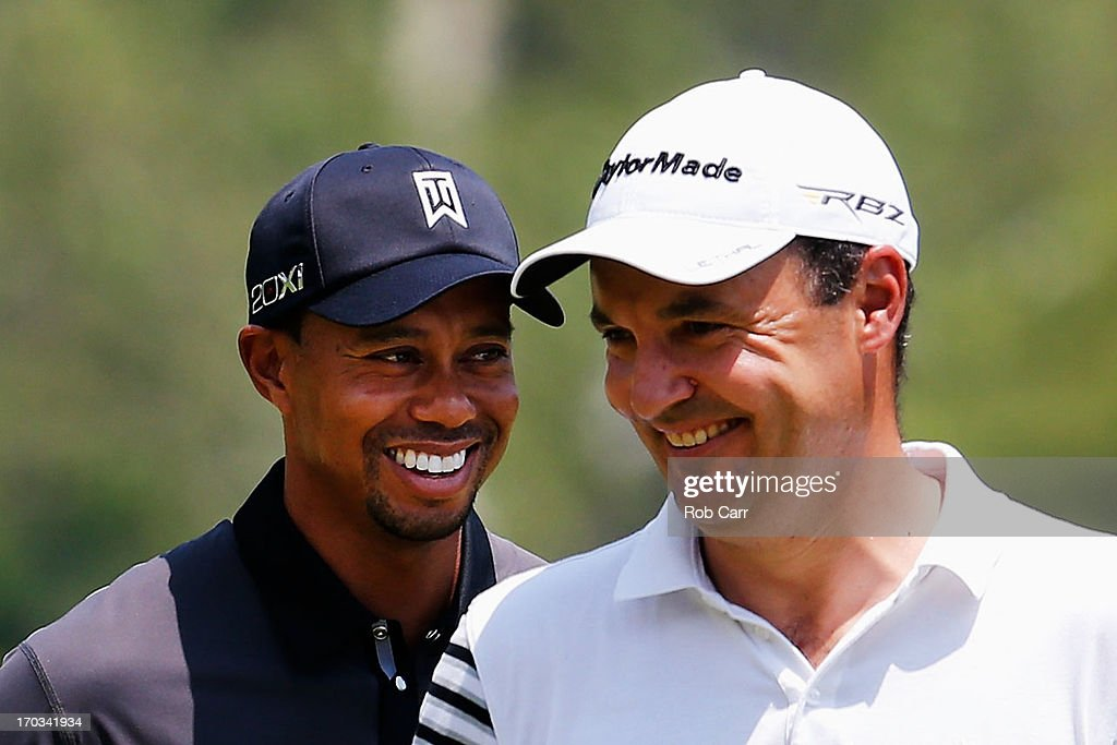 <a gi-track='captionPersonalityLinkClicked' href=/galleries/search?phrase=Tiger+Woods&family=editorial&specificpeople=157537 ng-click='$event.stopPropagation()'>Tiger Woods</a> of the United States and <a gi-track='captionPersonalityLinkClicked' href=/galleries/search?phrase=Simon+Khan&family=editorial&specificpeople=215124 ng-click='$event.stopPropagation()'>Simon Khan</a> of England smiles during a practice round prior to the start of the 113th U.S. Open at Merion Golf Club on June 11, 2013 in Ardmore, Pennsylvania.