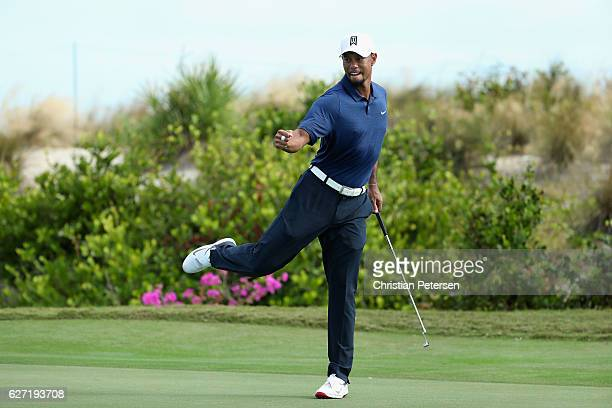Tiger Woods of the United States celebrates a birdie putt on the 16th green during round two of the Hero World Challenge at Albany The Bahamas on...