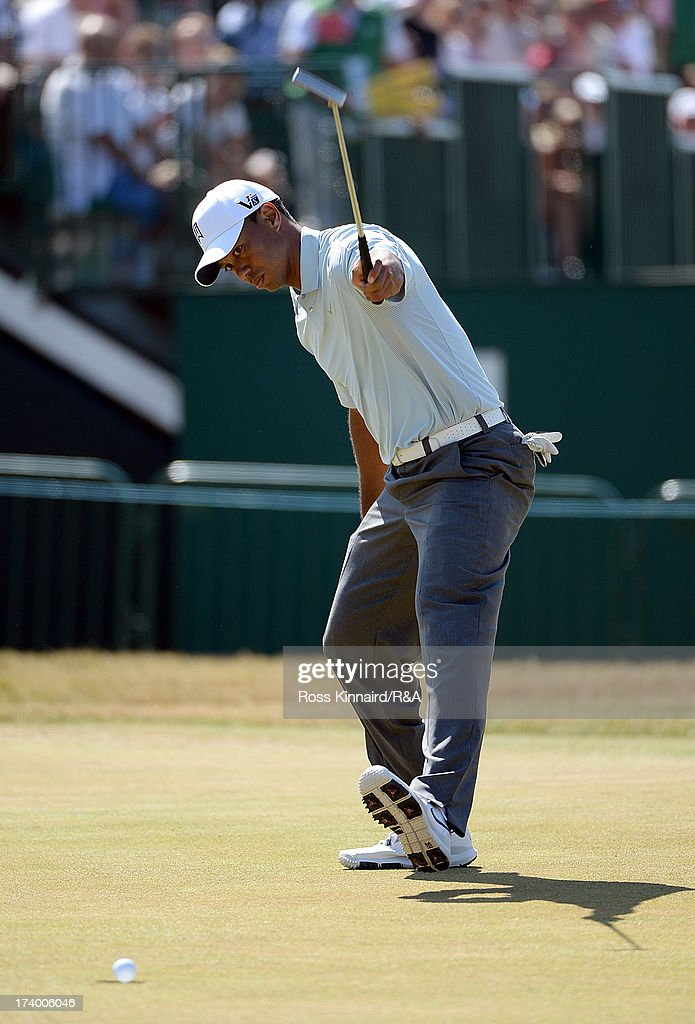 <a gi-track='captionPersonalityLinkClicked' href=/galleries/search?phrase=Tiger+Woods&family=editorial&specificpeople=157537 ng-click='$event.stopPropagation()'>Tiger Woods</a> of the United States celebrates holing a birdie putt on the 18th green during the second round of the 142nd Open Championship at Muirfield on July 19, 2013 in Gullane, Scotland.
