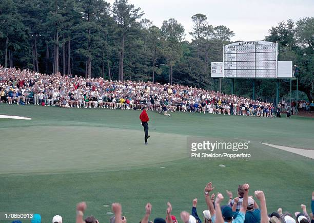 Tiger Woods of the United States celebrates on the 18th green after winning the US Masters Golf Tournament held at the Augusta National Golf Club in...