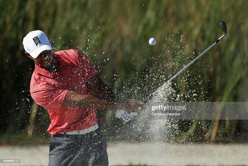 Tiger Woods of the United States chips from the bunker onto the fifth green during the pro-am ahead of the Hero World Challenge at Albany, The Bahamas on November 30, 2016 in Nassau, Bahamas.