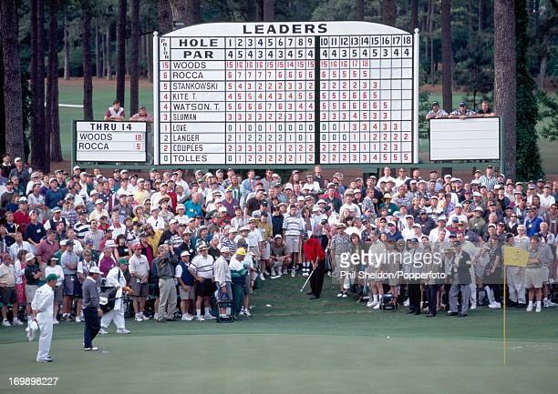 Tiger Woods of the United States chips onto the 15th green during the last round of the US Masters Golf Tournament held at the Augusta National Golf...