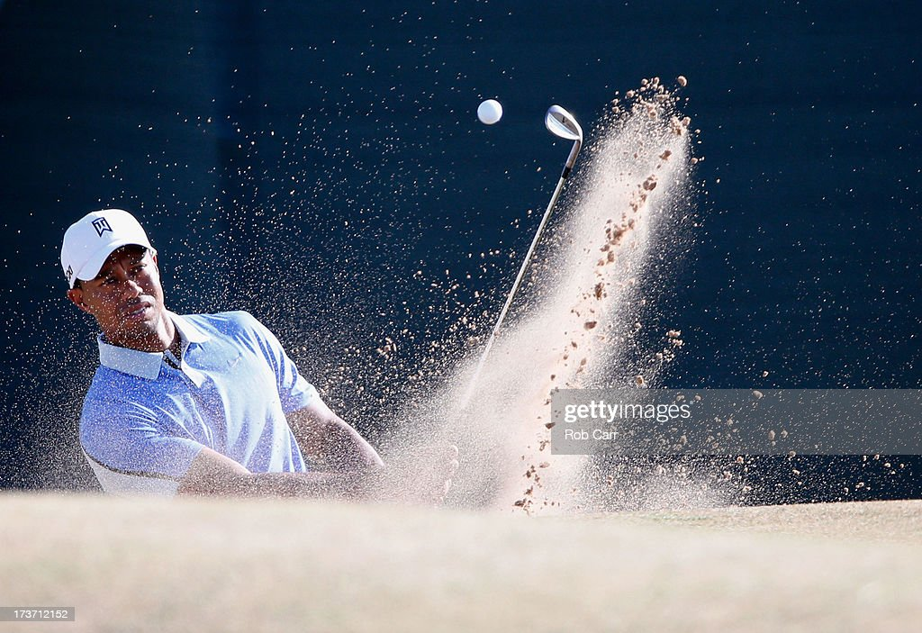 Tiger Woods of the United States chips out of a bunker ahead of the 142nd Open Championship at Muirfield on July 17, 2013 in Gullane, Scotland.