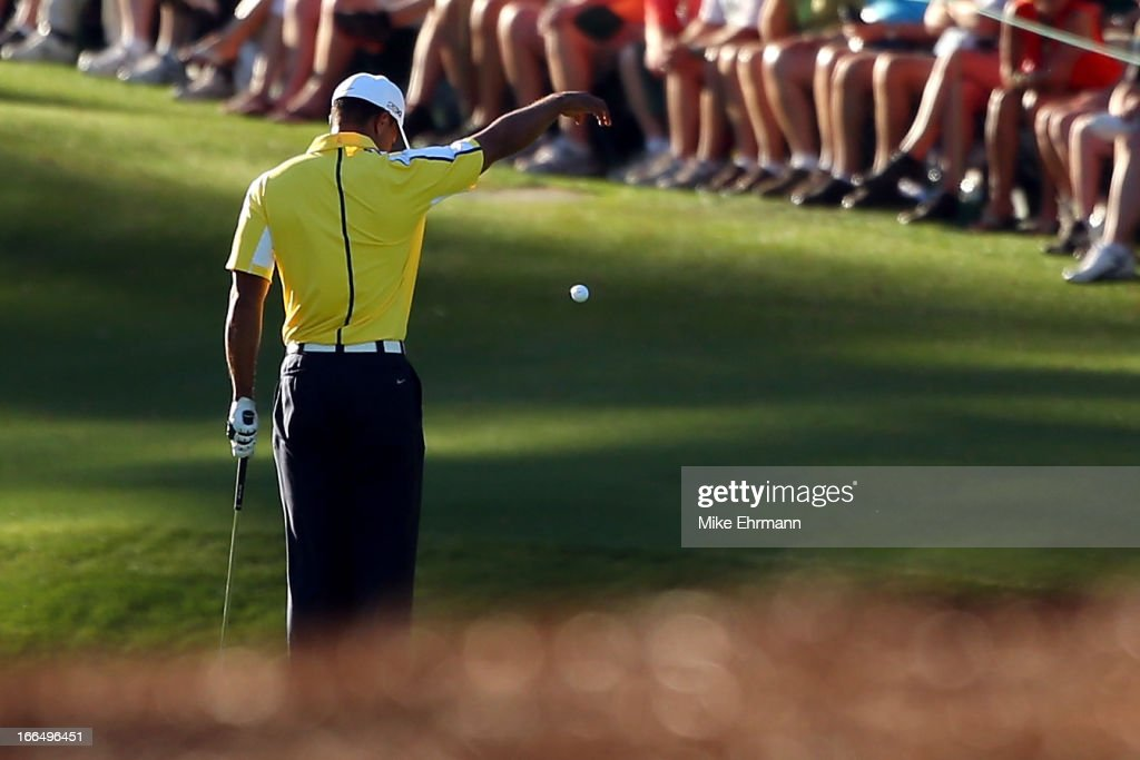 Tiger Woods of the United States drops his ball after he hits it into the water on the 15th hole during the second round of the 2013 Masters Tournament at Augusta National Golf Club on April 12, 2013 in Augusta, Georgia.