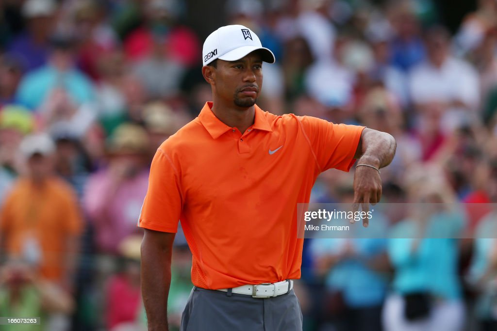 Tiger Woods of the United States gestures during a practice round prior to the start of the 2013 Masters Tournament at Augusta National Golf Club on April 8, 2013 in Augusta, Georgia.