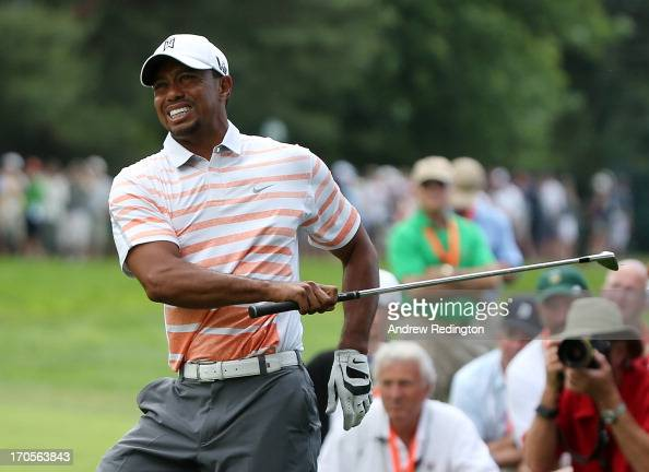 Tiger Woods of the United States grimaces after hitting his second shot on the eighth hole during Round Two of the 113th US Open at Merion Golf Club...