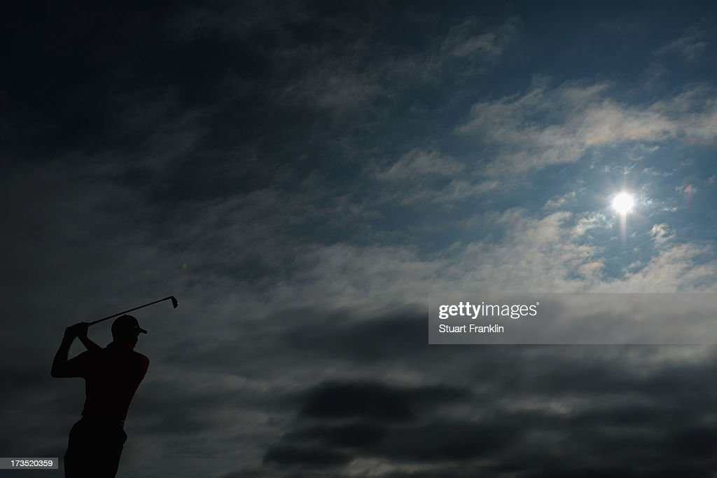 Tiger Woods of the United States hits a shot ahead of the 142nd Open Championship at Muirfield on July 16, 2013 in Gullane, Scotland.