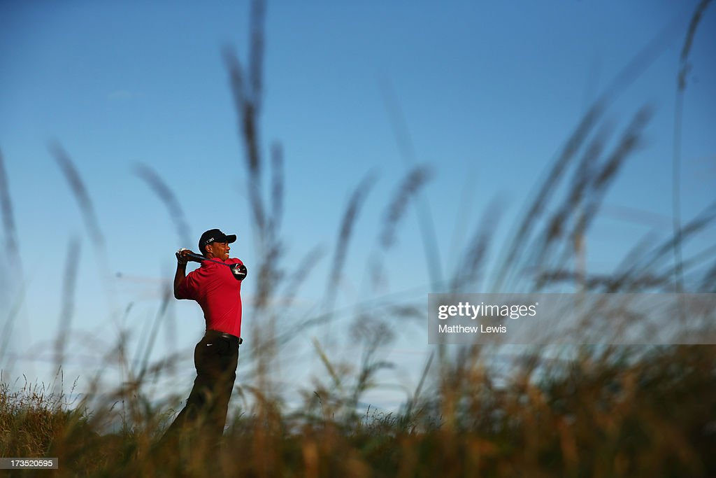 <a gi-track='captionPersonalityLinkClicked' href=/galleries/search?phrase=Tiger+Woods&family=editorial&specificpeople=157537 ng-click='$event.stopPropagation()'>Tiger Woods</a> of the United States hits a shot ahead of the 142nd Open Championship at Muirfield on July 16, 2013 in Gullane, Scotland.