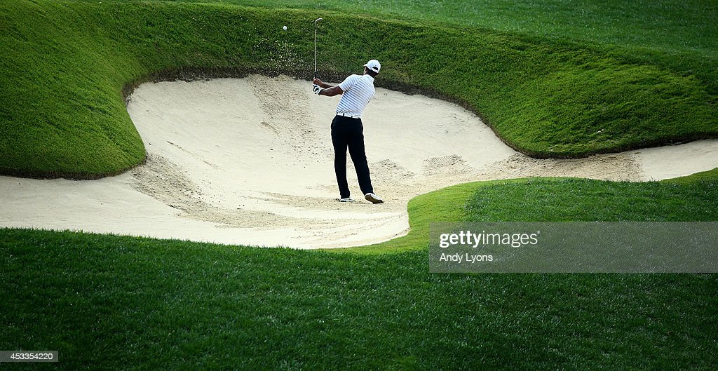 <a gi-track='captionPersonalityLinkClicked' href=/galleries/search?phrase=Tiger+Woods&family=editorial&specificpeople=157537 ng-click='$event.stopPropagation()'>Tiger Woods</a> of the United States hits a shot from a bunker on the 12th hole during the second round of the 96th PGA Championship at Valhalla Golf Club on August 8, 2014 in Louisville, Kentucky.