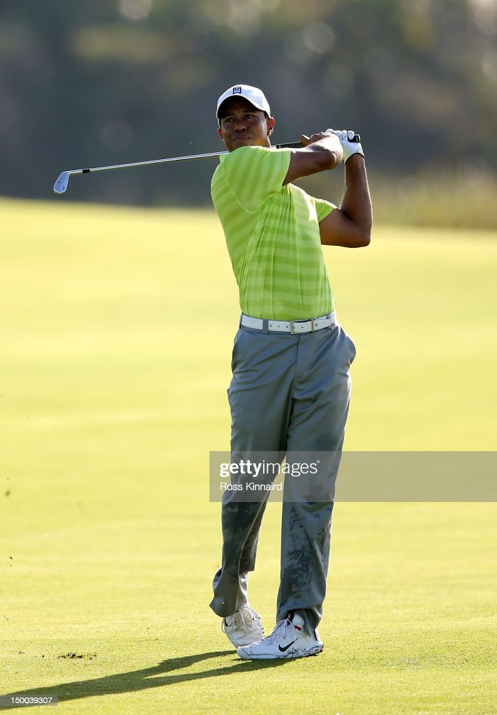 <a gi-track='captionPersonalityLinkClicked' href=/galleries/search?phrase=Tiger+Woods&family=editorial&specificpeople=157537 ng-click='$event.stopPropagation()'>Tiger Woods</a> of the United States hits a shot from the 11th fairway during Round One of the 94th PGA Championship at the Ocean Course on August 9, 2012 in Kiawah Island, South Carolina.