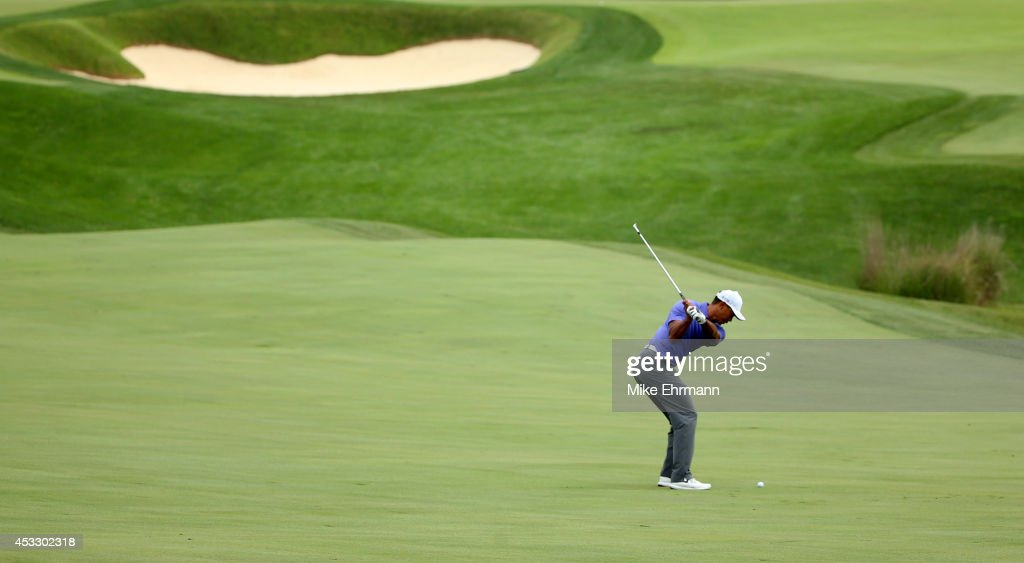 <a gi-track='captionPersonalityLinkClicked' href=/galleries/search?phrase=Tiger+Woods&family=editorial&specificpeople=157537 ng-click='$event.stopPropagation()'>Tiger Woods</a> of the United States hits a shot on the 18th hole during the first round of the 96th PGA Championship at Valhalla Golf Club on August 7, 2014 in Louisville, Kentucky.