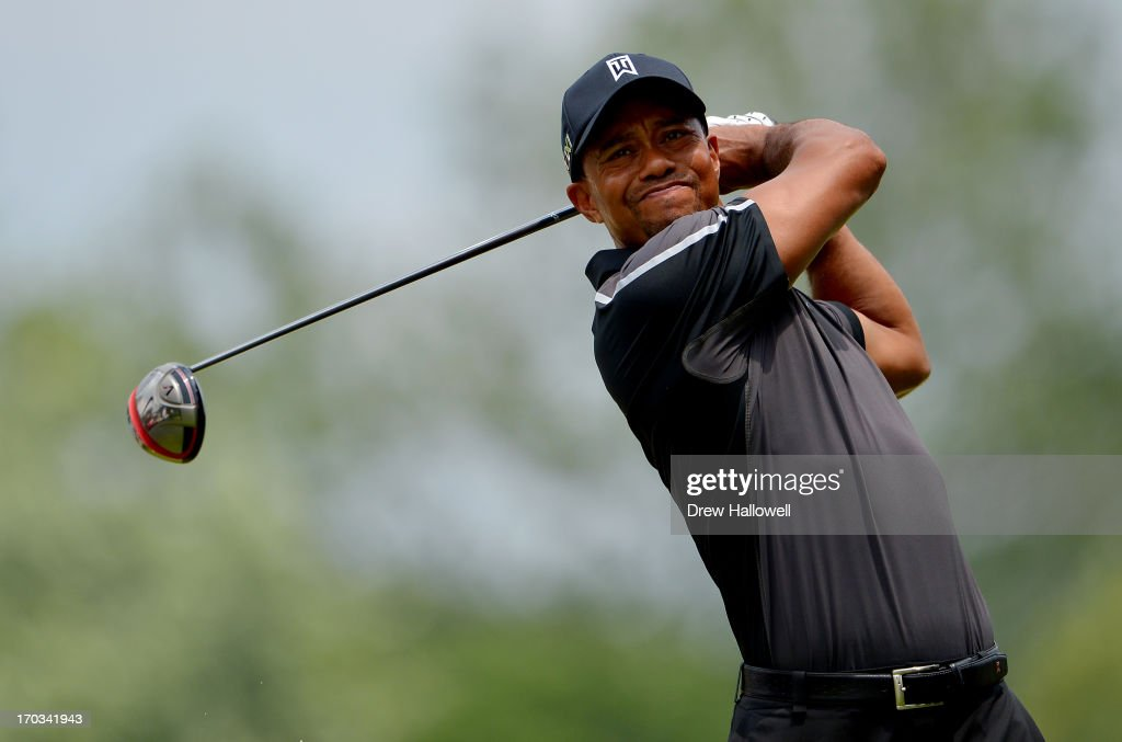 Tiger Woods of the United States hits a tee shot during a practice round prior to the start of the 113th U.S. Open at Merion Golf Club on June 11, 2013 in Ardmore, Pennsylvania.