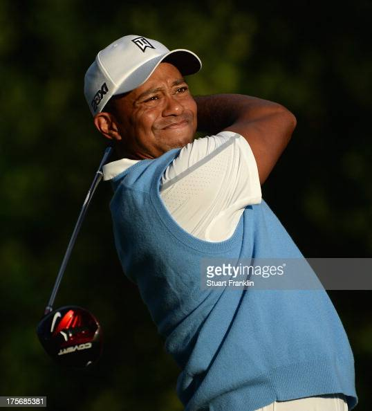 Tiger Woods of the United States hits a tee shot during a practice round prior to the start of the 95th PGA Championship at Oak Hill Country Club on...