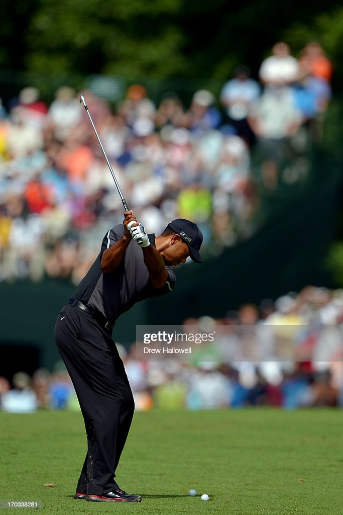 <a gi-track='captionPersonalityLinkClicked' href=/galleries/search?phrase=Tiger+Woods&family=editorial&specificpeople=157537 ng-click='$event.stopPropagation()'>Tiger Woods</a> of the United States hits an approach shot during a practice round prior to the start of the 113th U.S. Open at Merion Golf Club on June 11, 2013 in Ardmore, Pennsylvania.