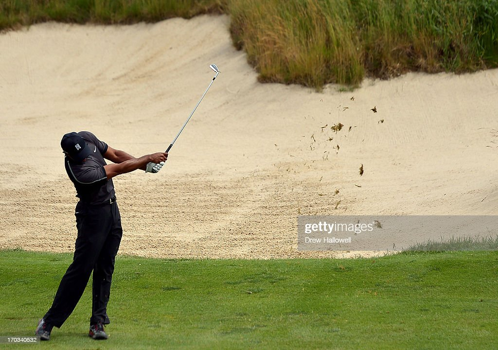Tiger Woods of the United States hits an approach shot during a practice round prior to the start of the 113th U.S. Open at Merion Golf Club on June 11, 2013 in Ardmore, Pennsylvania.