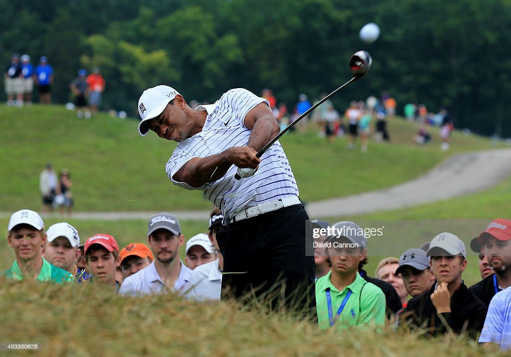 <a gi-track='captionPersonalityLinkClicked' href=/galleries/search?phrase=Tiger+Woods&family=editorial&specificpeople=157537 ng-click='$event.stopPropagation()'>Tiger Woods</a> of the United States hits an approach shot from the rough on the sixth hole during the second round of the 96th PGA Championship at Valhalla Golf Club on August 8, 2014 in Louisville, Kentucky.