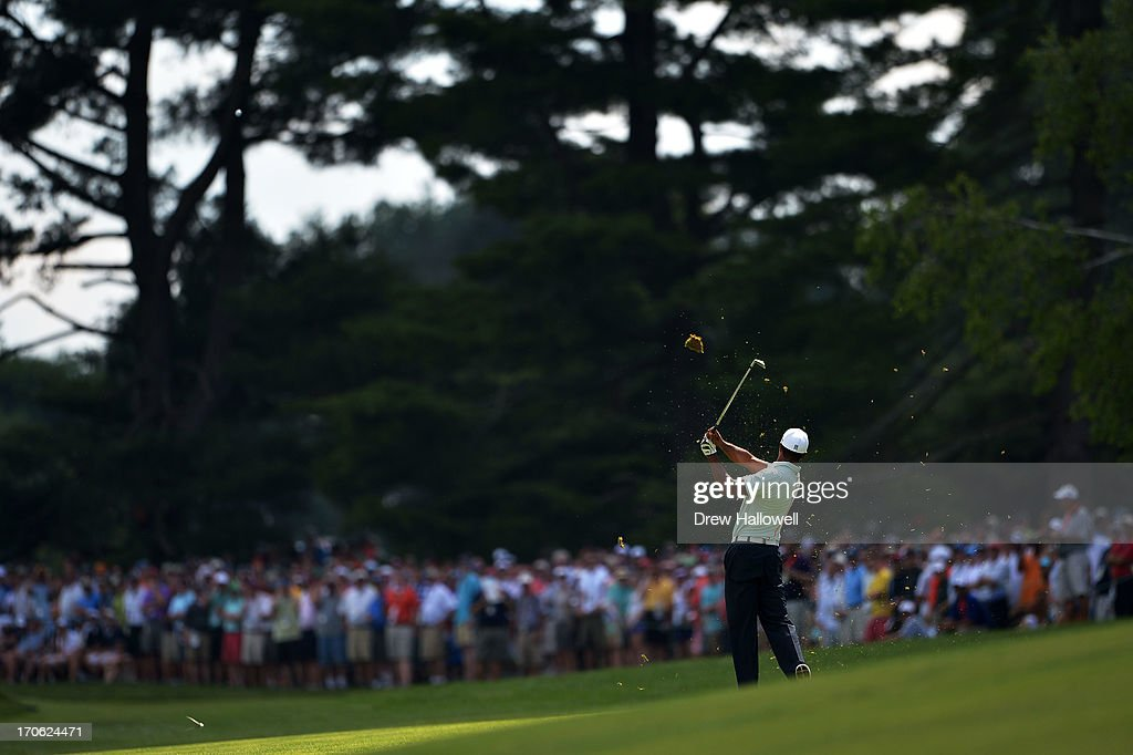 <a gi-track='captionPersonalityLinkClicked' href=/galleries/search?phrase=Tiger+Woods&family=editorial&specificpeople=157537 ng-click='$event.stopPropagation()'>Tiger Woods</a> of the United States hits an approach shot on the fifth hole during Round Three of the 113th U.S. Open at Merion Golf Club on June 15, 2013 in Ardmore, Pennsylvania.