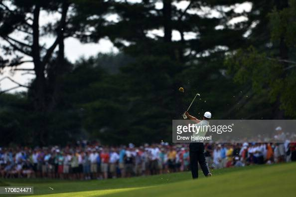 Tiger Woods of the United States hits an approach shot on the fifth hole during Round Three of the 113th US Open at Merion Golf Club on June 15 2013...