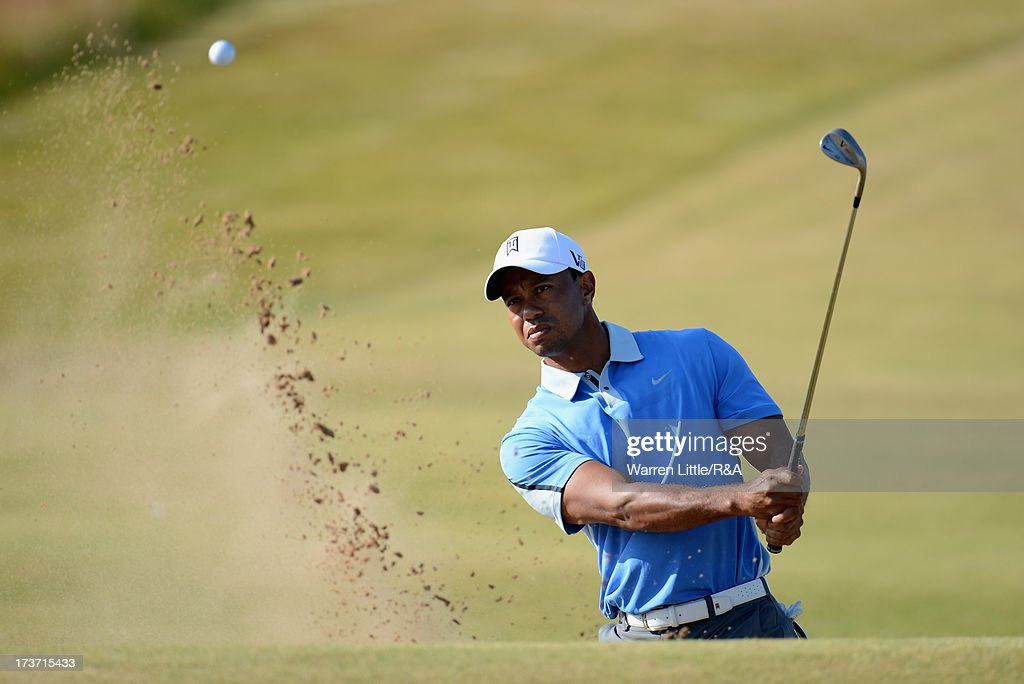 Tiger Woods of the United States hits from a bunker on the 11th hole ahead of the 142nd Open Championship at Muirfield on July 17, 2013 in Gullane, Scotland.