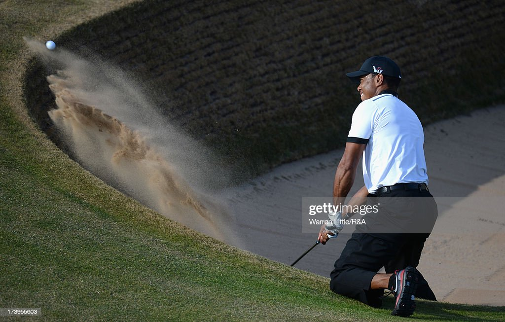 Tiger Woods of the United States hits from a bunker on the 12th hole during the first round of the 142nd Open Championship at Muirfield on July 18, 2013 in Gullane, Scotland.