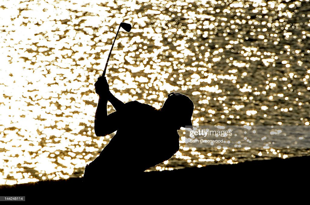 <a gi-track='captionPersonalityLinkClicked' href=/galleries/search?phrase=Tiger+Woods&family=editorial&specificpeople=157537 ng-click='$event.stopPropagation()'>Tiger Woods</a> of the United States hits his approach shot on the 18th hole during the second round of THE PLAYERS Championship held at THE PLAYERS Stadium course at TPC Sawgrass on May 11, 2012 in Ponte Vedra Beach, Florida.