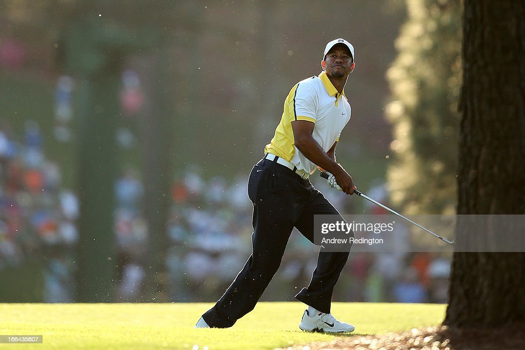 Tiger Woods of the United States hits his second shot on the 17th hole during the second round of the 2013 Masters Tournament at Augusta National Golf Club on April 12, 2013 in Augusta, Georgia.