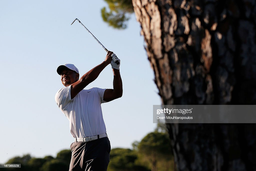 Tiger Woods of the United States hits his second shot on the 17th hole during the second round of the Turkish Airlines Open at The Montgomerie Maxx Royal Course on November 8, 2013 in Antalya, Turkey.