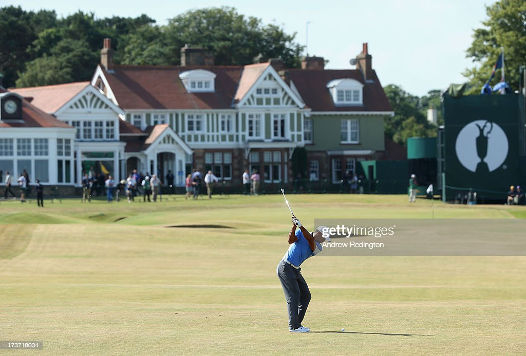 Tiger Woods of the United States hits his second shot on the 18th hole ahead of the 142nd Open Championship at Muirfield on July 17, 2013 in Gullane, Scotland.