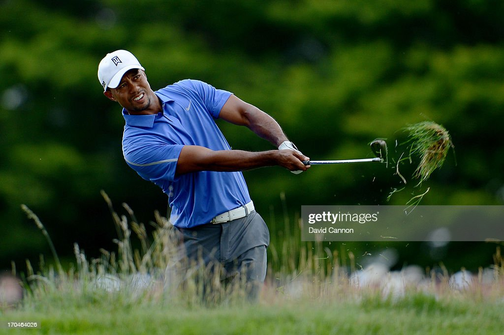 <a gi-track='captionPersonalityLinkClicked' href=/galleries/search?phrase=Tiger+Woods&family=editorial&specificpeople=157537 ng-click='$event.stopPropagation()'>Tiger Woods</a> of the United States hits his second shot on the first hole during Round One of the 113th U.S. Open at Merion Golf Club on June 13, 2013 in Ardmore, Pennsylvania.