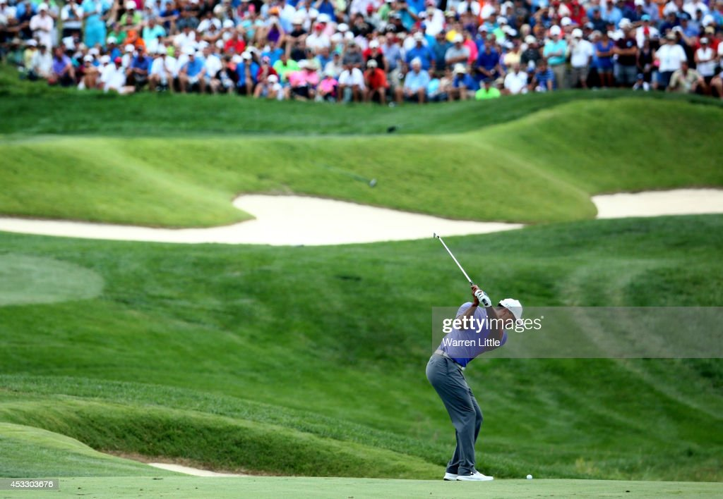 Tiger Woods of the United States hits his second shot on the ninth hole during the first round of the 96th PGA Championship at Valhalla Golf Club on August 7, 2014 in Louisville, Kentucky.
