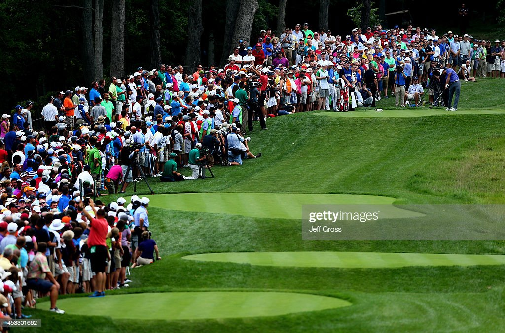 <a gi-track='captionPersonalityLinkClicked' href=/galleries/search?phrase=Tiger+Woods&family=editorial&specificpeople=157537 ng-click='$event.stopPropagation()'>Tiger Woods</a> of the United States hits his tee shot on the 17th hole during the first round of the 96th PGA Championship at Valhalla Golf Club on August 7, 2014 in Louisville, Kentucky.