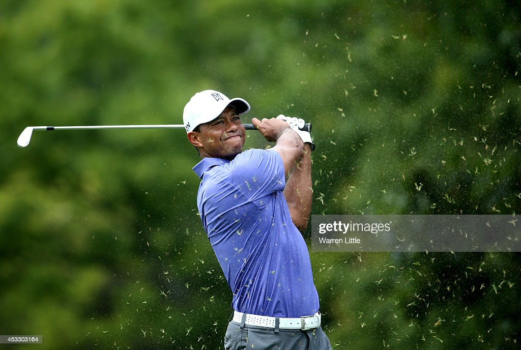 <a gi-track='captionPersonalityLinkClicked' href=/galleries/search?phrase=Tiger+Woods&family=editorial&specificpeople=157537 ng-click='$event.stopPropagation()'>Tiger Woods</a> of the United States hits his tee shot on the eighth hole during the first round of the 96th PGA Championship at Valhalla Golf Club on August 7, 2014 in Louisville, Kentucky.