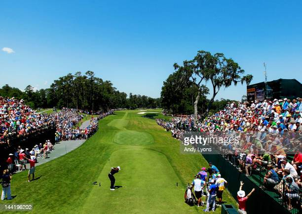 Tiger Woods of the United States hits his tee shot on the first hole in front of a gallery of patrons during the second round of THE PLAYERS...