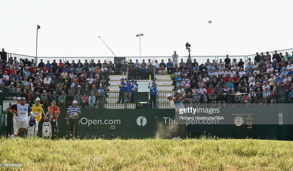 Tiger Woods of the United States hits his tee shot on the first hole as a gallery of fans look on during the first round of The 143rd Open...