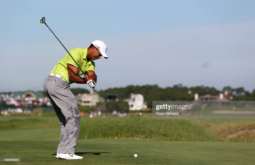 <a gi-track='captionPersonalityLinkClicked' href=/galleries/search?phrase=Tiger+Woods&family=editorial&specificpeople=157537 ng-click='$event.stopPropagation()'>Tiger Woods</a> of the United States hits off the 12th tee during Round One of the 94th PGA Championship at the Ocean Course on August 9, 2012 in Kiawah Island, South Carolina.