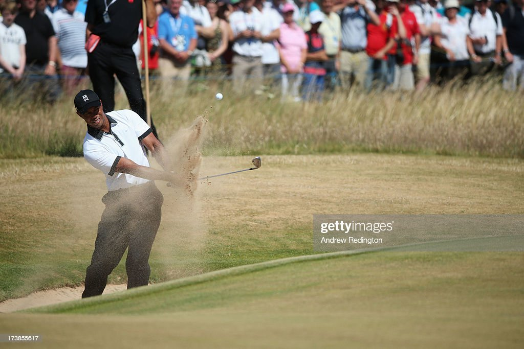 Tiger Woods of the United States hits out of a bunker on the 1st hole during the first round of the 142nd Open Championship at Muirfield on July 18, 2013 in Gullane, Scotland.