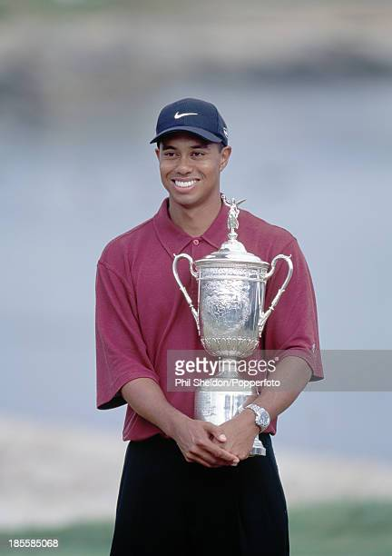 Tiger Woods of the United States holding the trophy after winning the US Open Golf Championship held at the Pebble Beach Golf Links in California...