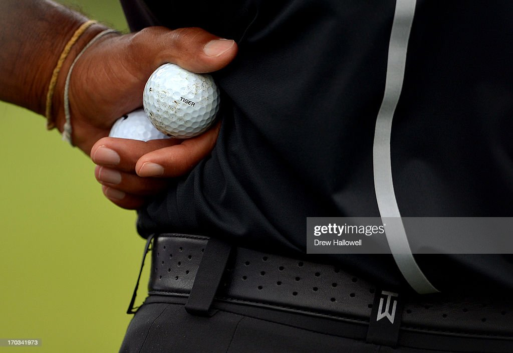 Tiger Woods of the United States holds two of his golf balls during a practice round prior to the start of the 113th U.S. Open at Merion Golf Club on June 11, 2013 in Ardmore, Pennsylvania.