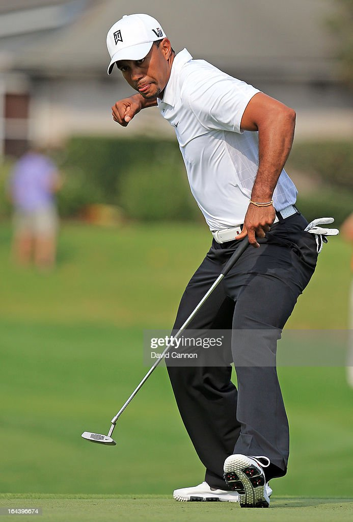 <a gi-track='captionPersonalityLinkClicked' href=/galleries/search?phrase=Tiger+Woods&family=editorial&specificpeople=157537 ng-click='$event.stopPropagation()'>Tiger Woods</a> of the United States holes a putt for eagle at the par 5, 16th hole during the third round of the 2013 Arnold Palmer Invitational Presented by Mastercard at Bay Hill Golf and Country Club on March 23, 2013 in Orlando, Florida.