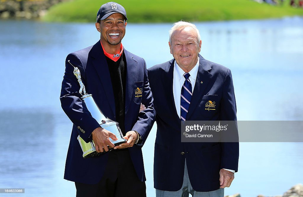 Tiger Woods of the United States is presented with the trophy by Arnold Palmer of the United States, the win meant he re-gained the World's number one position after the final round of the 2013 Arnold Palmer Invitational Presented by Mastercard at Bay Hill Golf and Country Club on March 25, 2013 in Orlando, Florida.