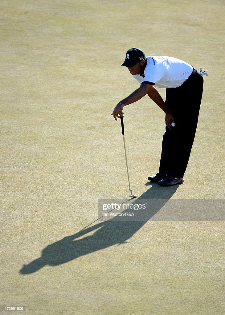 Tiger Woods of the United States lines up a putt during the first round of the 142nd Open Championship at Muirfield on July 18, 2013 in Gullane, Scotland.