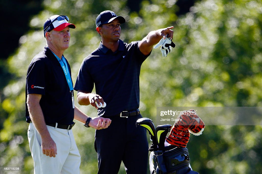 <a gi-track='captionPersonalityLinkClicked' href=/galleries/search?phrase=Tiger+Woods&family=editorial&specificpeople=157537 ng-click='$event.stopPropagation()'>Tiger Woods</a> of the United States lines up a shot with his caddie <a gi-track='captionPersonalityLinkClicked' href=/galleries/search?phrase=Joe+LaCava&family=editorial&specificpeople=695531 ng-click='$event.stopPropagation()'>Joe LaCava</a> during a practice round prior to the 2015 PGA Championship at Whistling Straits on August 12, 2015 in Sheboygan, Wisconsin.