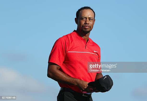 Tiger Woods of the United States looks on as he walks off the 18th hole during the final round of the Hero World Challenge at Albany The Bahamas on...